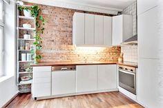 Brick wall behind kitchen