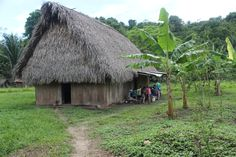 IZE's guide's home in the Village of Blue Creek where an crafts demonstration is taking place with IZE students