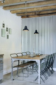Industrial Dining Room with Corrugated Wall | PAD Studio