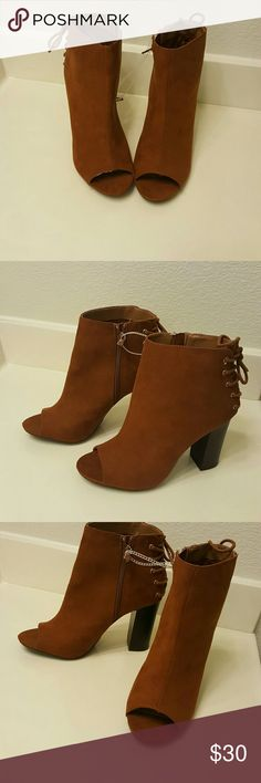 GORGEOUS SUEDE PEEP TOE HEELS Gorgeous chestnut color suede peep toe heels Zippers on the inner side of the shoes With a cute lace up shoe string design on the back of them Thick 4in heel True to size Never worn Brand new tag fell off Shoes Heels