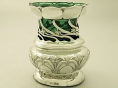An impressive antique Edwardian English sterling silver and green coloured glass vase in the Art Nouveau style