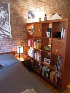 ikea bookcase as a room divider - i want to live somewhere in such an open floorplan that i need a room divider!