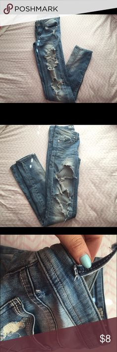 Extremely distressed denim Super skinny EXTREMELY distressed denim jeans, belt loop broken but can easily be sewn back, last photo: bought the jeans as is Pants Skinny
