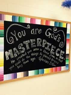 I used paint chips from the hardware store as a border on top of black bulletin board paper. I hand-lettered the verse using a chalk pen! People have to look very closely to realize it's not a real chalkboard.