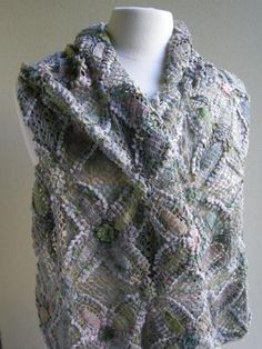 This dazzling Reguilette Scarf by Sophie Digard is a textural wonder of handcrocheted linen. In ethereal blues, beiges, sages and lilacs.