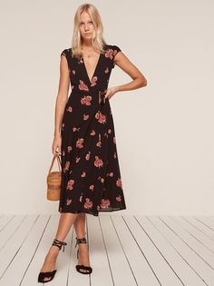 For that thing this weekend.  This is a midi length, wrap dress with a high slit, a deep v neckline and a cap sleeve.