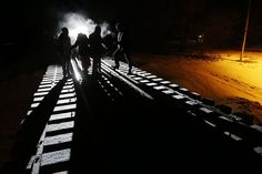 Migrants from Somalia cross into Canada from the United States by walking down a train track early Sunday, Feb. 26, 2017, into the town of Emerson, Manitoba, where they will seek asylum at the Canada Border Services Agency. (Photo: John Woods/The Canadian Press via AP)