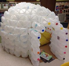 What a good idea for the kids to make use of all the plastic milk jugs we buy! This milk jug igloo is another kind of fort the little ones will enjoy. :) This recycling idea is commonly done as a s… Milk Jug Projects, Milk Jug Igloo, Milk Carton Crafts, Milk Cartons, Milk Jugs, Igloo Craft, Plastic Milk Bottles, Water Bottles, Plastic Containers