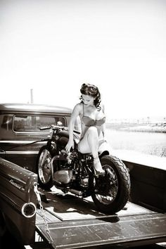Bike, truck, girl... What more would one want in a picture? | Pinup Girl  http://thepinuppodcast.com features pinup models and pin up photographers.
