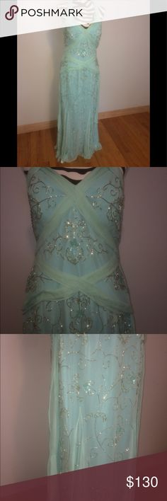 NWT Sean Couture Beaded Aqua Gorgeous Formal Dress This beautiful NWT dress is perfect for your next formal event. Features beading, a sexy back design, and flows details. Sean Couture Dresses Prom