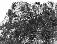 "Mt. Rushmore in 1905 before artist Gutzon Borglum began sculpting portraits of the U.S. Presidents in 1927.  It's so amazing that this photo exists - we just had to share it!  Hit ""Share"" to pass on the history from >> Old Photo Archive"