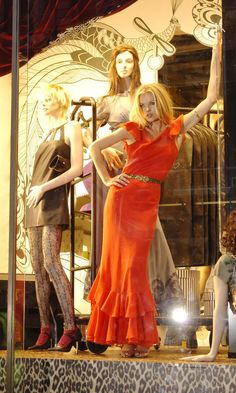 Kate Moss poses in the window of the flagship Topshop in Oxford Street to launch her first collection for the fashion high street store.