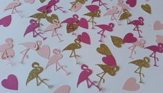 Pinks and glitter gold flamingo and hearts confetti. Pink flamingo table…