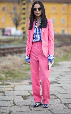 A zippy trouser suit in an eye-catching hue will always make an impact, yet this showgoer's exposed gingham cuffs really makethis outfit sing