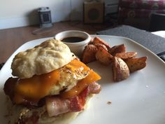 Bacon egg & cheese on homemade buttermilk biscuit with taters & BBQ sauce. My day off breakfast #sandwiches #food #lunch #love #salads #recipe #breakfast #coffee #foodie #foodporn