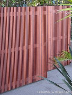 Narrow Vertical Timber Slat Screen For Privacy And A Division Of Space Fences And Screens