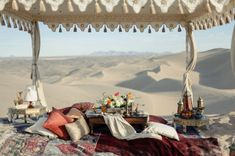 tented wedding - moroccan wedding inspiration. Love the layers of rugs and fabrics.. low furniture.