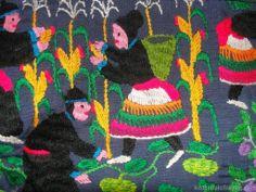 Detail on an embroidered Paj Ntaub (story cloths) farming scene bag from Laos via Red Buffalo Trading