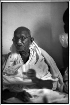 Henri Cartier-Bresson  INDIA. Delhi. Birla House. 1948. GANDHI, just after breaking his fast.