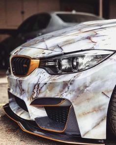 BMW M4 with marble wrap.  Travel In Style | #MichaelLouis - www.MichaelLouis.com