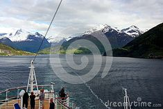 Tourists on deck of cruise ship through fjords in Norway.