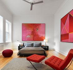 A bright red Barcelona Chair is perfect for this bedroom.