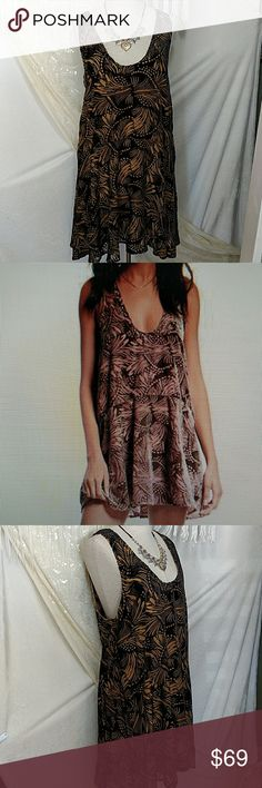 """NWT!  Free People Ellie Burnout Velvet Mini Dress Gorgeous burnout design gives this mini dress a Bohemian vibe!  Metallic studs detail the scooped neckline.  Slip-on style. Lined. 61% viscose/39% nylon (hand wash cold, line dry).  Length: approx 34""""L.  Color:. Black and gold Free People Dresses Mini"""