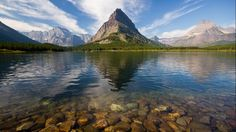 Swiftcurrent Lake is located in the Many Glacier region of Glacier National Park, in Montana. The fast disappearing Grinnell Glacier is one of several glaciers and snowfields that provide water for the streams that replenish the lake, which lies at 4,878 feet above sea level. (Flickr/Jeff P)