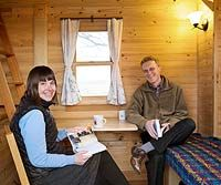 Tammy and Logan in their Tiny House (Click through to read about why they chose to live small)