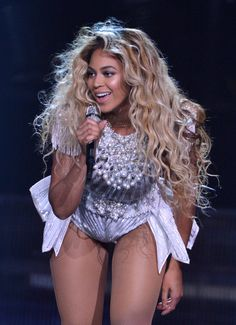 "June at the North American opening of ""The Mrs. Carter Show World Tour."" See all of Beyoncé's best hair moments of 2013!"