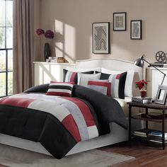 Update your master bedroom with the Madison Park Bay Ridge Comforter Collection. The rich red microsuede is pieced with two shades of grey giving a tiled look to the center of the bed.