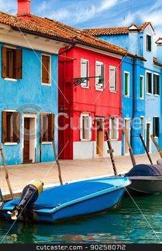 Blue And Red Buildings in Burano stock photo, Vibrant colored buildings along canal in Burano, Italy. by eZeePics Studio