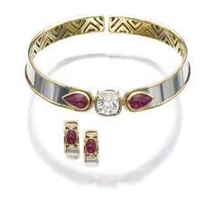 Ruby and diamond demi-parure, Marina B Comprising: a flexible choker set to the front with a cushion-shaped diamond of yellow tint, highlighted at either side with a pear-shaped cabochon rubies, with matching earrings.