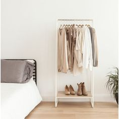 Find a great selection of garment racks and wardrobe closets for sale at Wayfair. They're perfect for the home, on set at a photo shoot, or for commercial use at a clothing store. Order your new clothes rack today! Closet Rod, Closet Storage, Closet Doors, Shoe Closet, Diy Storage, Clothes Storage Systems, Clothing Organization, Bedroom Organization, Clothing Storage