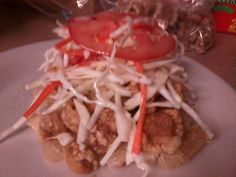 Vigorón, Nicaraguan dish - Chicharrones topped with chilero salad: cabbage, tomato and carrot