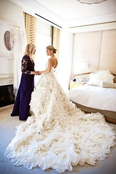 Mother of Bride with daughter photo.  Wedding dress with beautiful long ruffled train