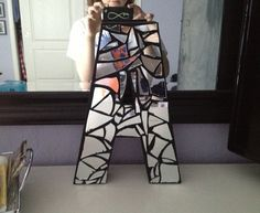DIY mirror mosaic monogram. Craft store paper mâché letter, painted, hot glue broken mirror shards!