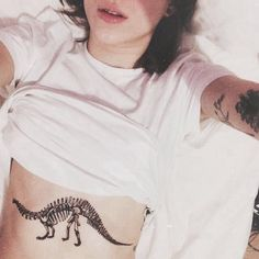 http://1337tattoos.com/post/107978753687/dinosaur-sternum-tattoo-submitted-by-gabrielle