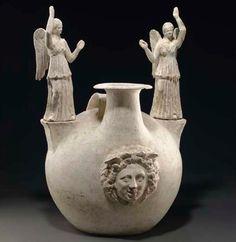 A CANOSAN POTTERY ASKOS CIRCA 300 B.C.