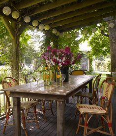 All a well-loved wood table needs are some comfy seats around it whether cafe chairs or bales of hay topped by blankets.