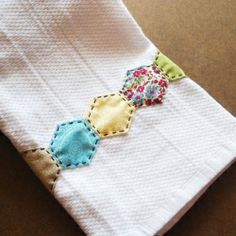 Embellish a kitchen towel with a few paper-pieced hexagons!