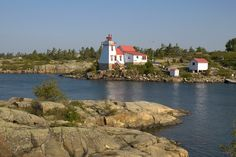 The lighthouse at Pointe au Baril Vacation Trips, Vacations, Arctic Circle, Largest Countries, American Country, Vancouver Island, Great Lakes, Pacific Ocean, Continents