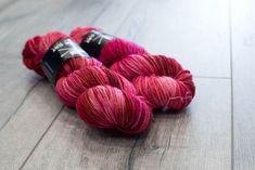 Worsted weight merino yarn. 100% Superwash Merino. Sweater weight yarn. Medium Weight yarn. Ruby Slippers. Multicolored red and pink yarn by blackcatcustomyarn on Etsy https://www.etsy.com/listing/564842495/worsted-weight-merino-yarn-100-superwash