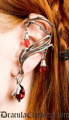 This single earring is in the shape of a rose thorn branch going up and around your ear, with blood red rhinestones delicately dangling off the tips of the earring.