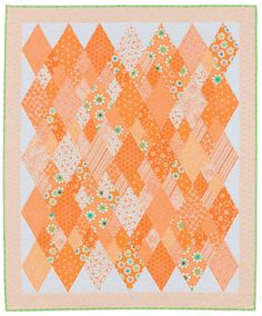 """The original name for this quilt from Me and My Sister Designs was Carats,"""" an ode to diamonds. But a change of color scheme left them seeing """"carrots"""" instead! Quilting Tutorials, Quilting Projects, Sewing Projects, Orange Quilt, Paper Quilt, Fat Quarter Quilt, Diamond Quilt, Quilt Patterns Free, Small Quilts"""
