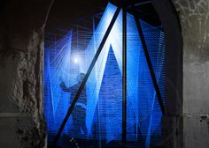 UK architect George King used ultra-violet wool thread to produce Lasermaze within an old train underpass in Detroit.