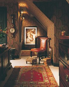 Quite a small space with lots of angles. The paisley wall, dark furniture, rug, leather, and mellow light just cast a glow over everything. Very sophisticated. Attic Rooms, Attic Spaces, Attic Playroom, Attic Apartment, Attic Bathroom, Paisley Wallpaper, Of Wallpaper, Attic Renovation, Attic Remodel