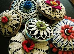 Vintage doily brooches.    Make pincushion from larger doily with felted wool and zipper between the seams.