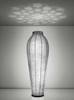 Flos, Chrysalis floor lamp by Flos. It's in the shape of a vase and projects your bunch of flowers onto the ceiling - genius!