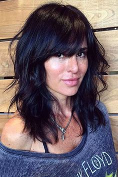 I haven't had bangs in about a decade... thinking about trying it out again! Medium Layered Hair with Bangs